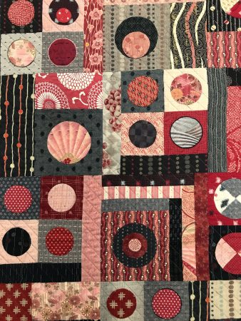detail of quilt with circles and squares